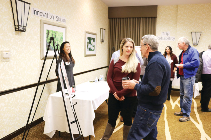 Highlands Ranch residents speak to representatives from the Colorado Department of Transportation at an open house about the C-470 expansion project. The Dec. 5 public meeting at the Hilton Garden Inn in Highlands Ranch drew about 30 community members, who had questions about the timeline, cost of tolls and noise.