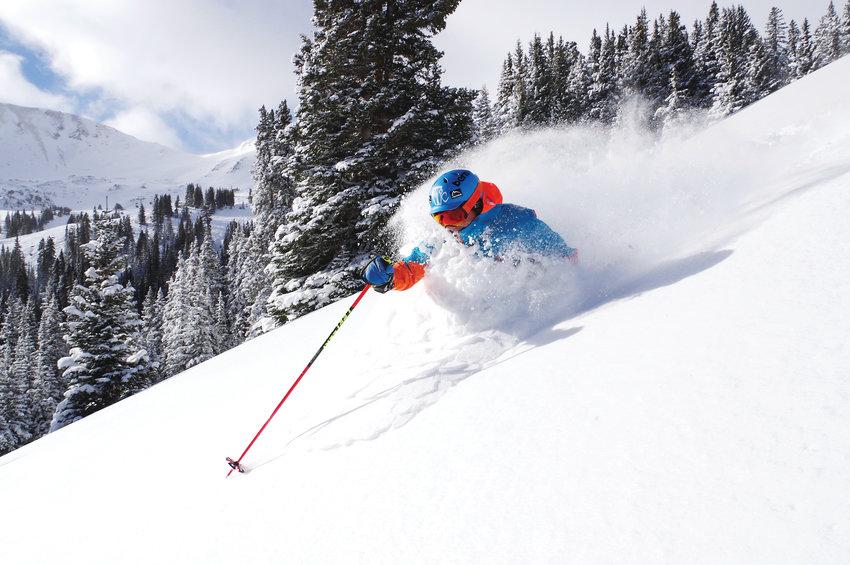 A skier skis through the powder at Loveland Ski Resort.
