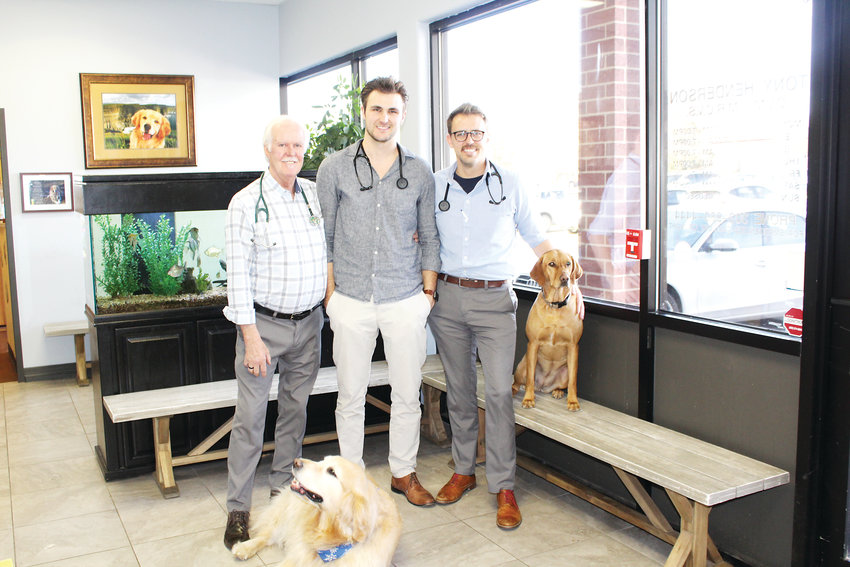 From left, Tony, Ross and Ryan Henderson inside Fox Hollow Animal Hospital.