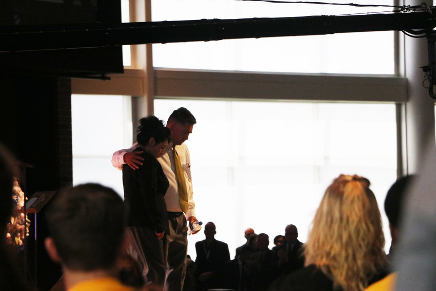 """Maria and John Castillo, the parents of Kendrick Castillo, who was killed in the STEM School Highlands Ranch shooting, walk off stage at a celebration of life service on May 15. """"I love you all,"""" John Castillo said minutes earlier. """"Thank you for loving my son."""""""