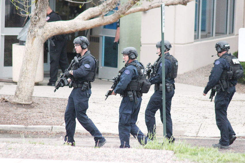Law enforcement personnel respond to STEM School Highlands Ranch on May 7. One student was killed and eight were wounded. Two students were arrested on suspicion of carrying out the attack.