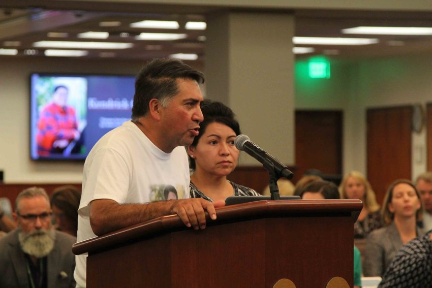 John Castillo addresses Douglas County comissioners alongside wife, Maria, about school security. The couple's son, Kendrick, was killed in the STEM School Highlands Ranch shooting.