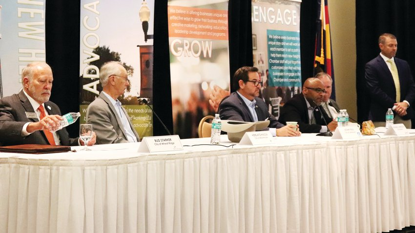 During the Arvada Chamber's Mayors Roundtable, fellow mayors listen as Denver Mayor Michael Hancock discusses strategies to connect the homeless with jobs. From left to right: Wheat Ridge Mayor Bud Starker, Westminster Mayor Herb Atchison, Lakewood Mayor Adam Paul, Denver Mayor Michael Hancock and Arvada Mayor Marc Williams.