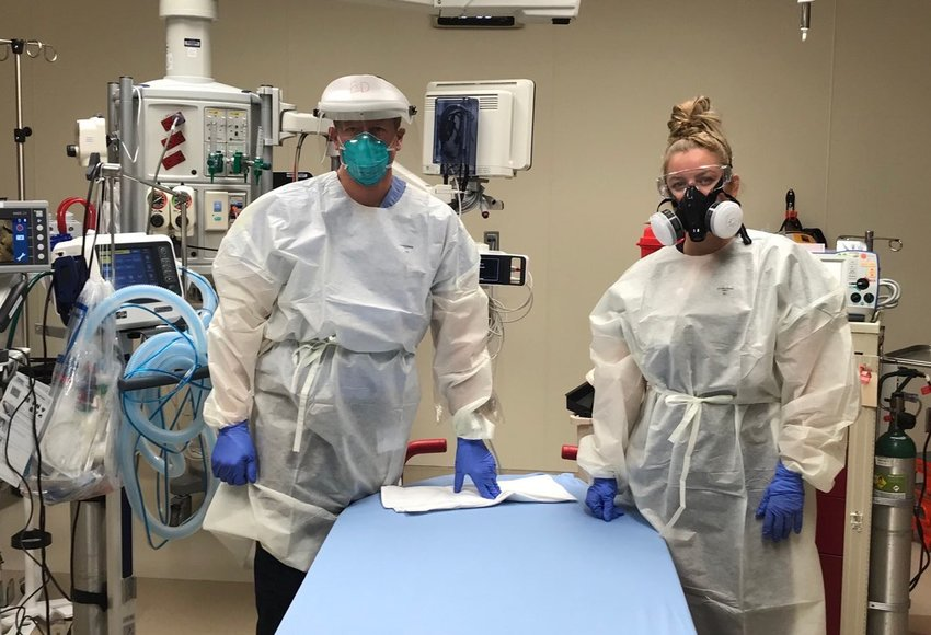 Dr. Kimber Bogush, emergency medicine physician, and emergency room nurse Mia Orr are pictured in the trauma bay during their shifts at the UCHealth Highlands Ranch Hospital Emergency Department on Friday, March 27, 2020.