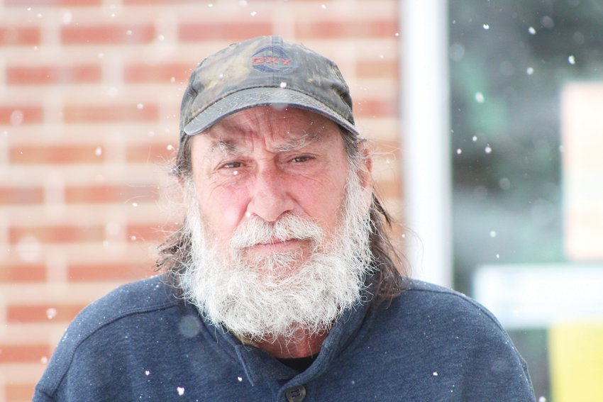Wayne Graham stands outside Mean Street Ministry in Lakewood on April 16. Graham, who said he was homeless at the time, said there was nowhere for him to go on cold days as places like libraries were closed because of the COVID-19 pandemic.