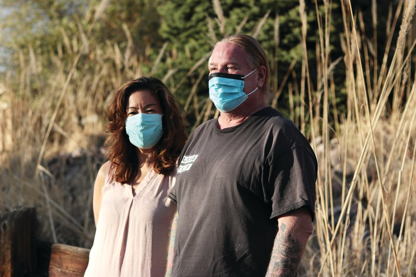 Barry Kittay, right, spent about 20 days in the hospital fighting COVID-19. He lost 55 pounds and his ability to walk while in the hospital. At left is his wife, Doe.