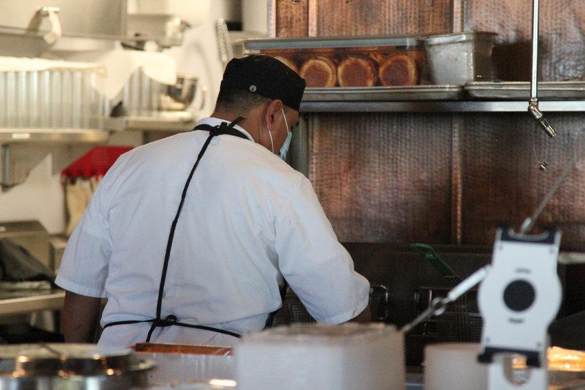 An employee at Sierra restaurant in Lone Tree.