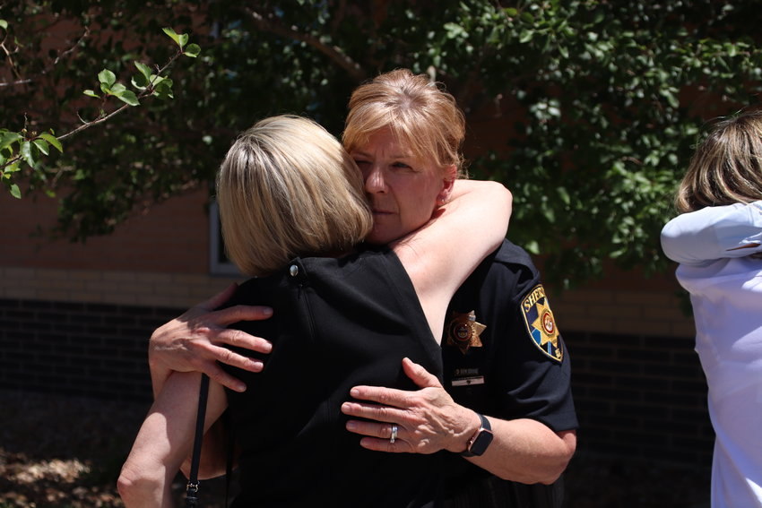 Undersheriff Holly Nicholson-Kluth embraces one of Helene Pruszynski's friends who traveled to Colorado for the sentencing July 1.