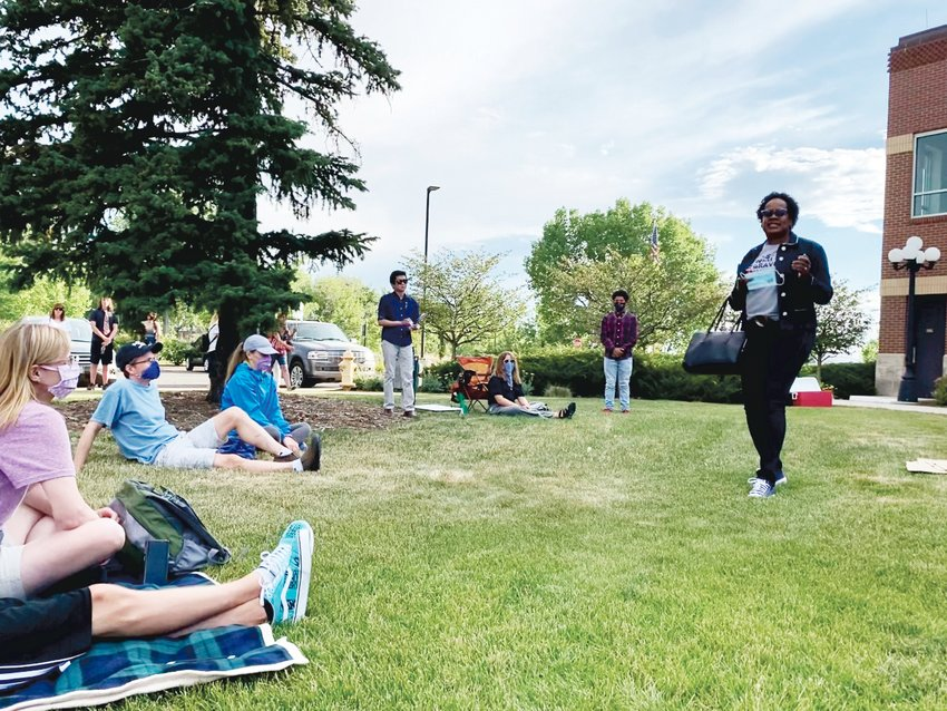 People sit on the lawn in front of Parker Town Hall July 3 for a protest in solidarity with the Black Lives Matter movement.