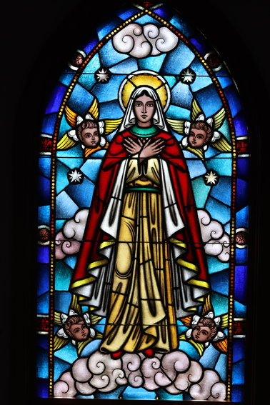 A stained glass image of Mother Cabrini inside the Mother Cabrini chapel at Mother Cabrini's Shrine.