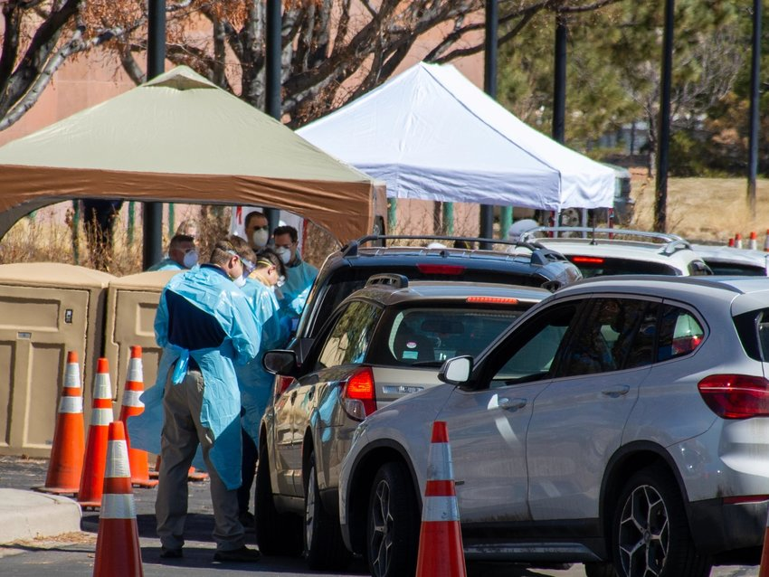 Health workers collect patient information from people waiting to be tested for COVID-19, the disease caused by the novel coronavirus, outside the Colorado Department of Public Health and Environment's lab in Denver's Lowry neighborhood. Photographed on March 11, 2020.