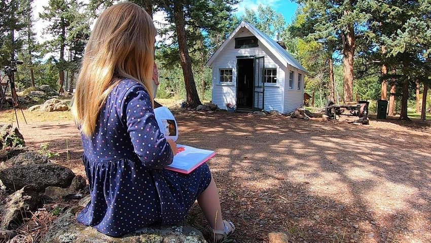 A rundown abandoned cabin near Evergreen has been transformed into a community library.