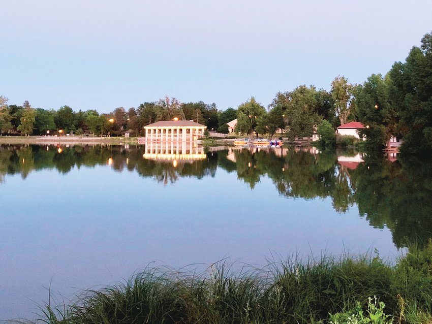 The 1913 Boathouse in Denver's Washington Park, pictured, dates back to an era when Smith Lake was a popular urban resort, with a swimming beach and winter skating.  Across the lake on the north shore is another vintage building, the 1912 Dos Chappell Bathhouse, which once provided beach-goers with locker rooms and showers. Currently it houses Volunteers for Outdoor Colorado, a nonprofit that tends to the state's natural resources.