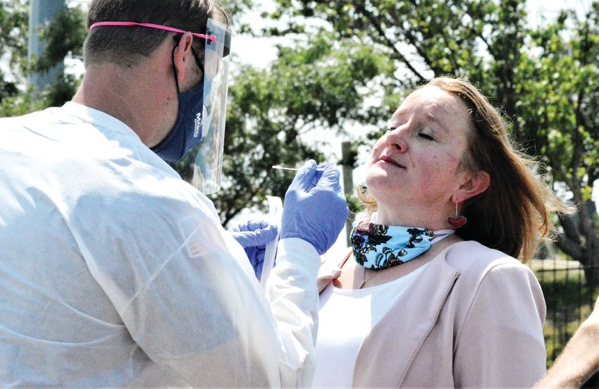 Adams County Commission Chair Emma Pinter prepares to be tested for COVID-19 Aug. 10 at the new Mako Medical testing station at Water World. Pinter and the other county commissioners were tested along with Gov. Jared Polis at the opening of the testing site.