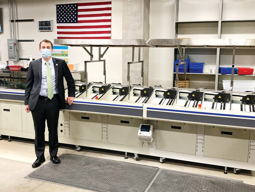 Jeffco Clerk and Recorder George Stern stands next to a ballot sorting machine, which is stored in the basement of the Jeffco Elections Office in Golden.