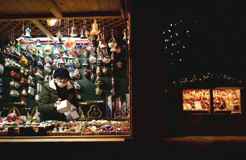 Astrid Hausdoerfer organizes ornaments at the Old German Christmas booth at the Denver Christkindl Market at Civic Cent Park in Denver on Nov. 24. The annual authentic German and European holiday traditional market is hosted by the German American Chamber of Commerce and features local and international vendors.