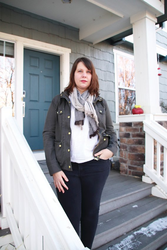 Sarah Tuneberg, whose home address was shared online, poses for a portrait on her front porch.