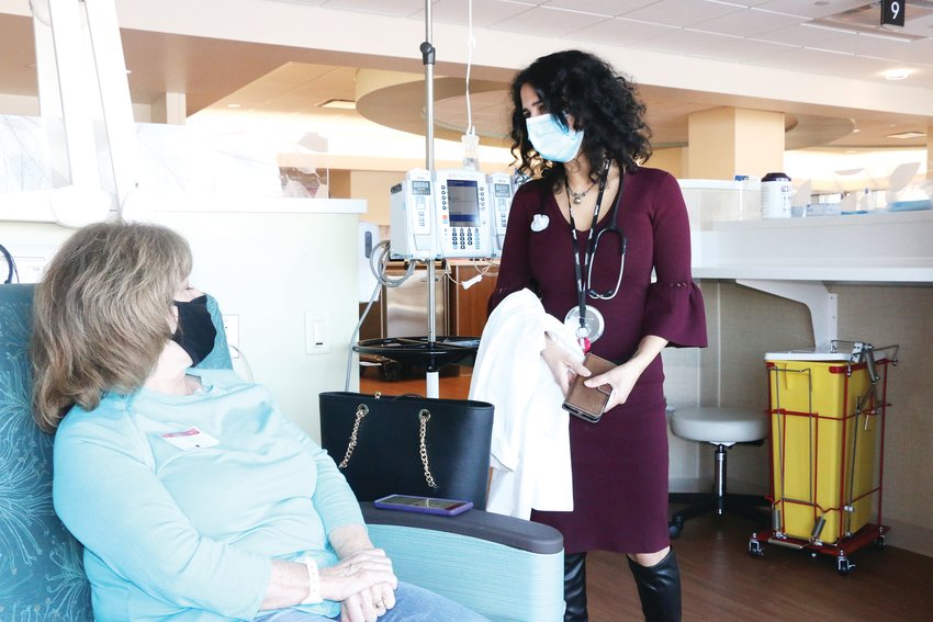 Dr. Radhika Acharya-Leon, section chief for medical oncology at Highlands Ranch Hospital, talks to patient Suzi McCumber about radiation treatment.