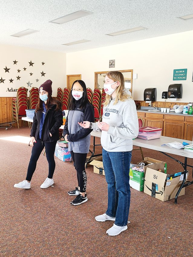 Mountain Vista students Bella Lewis, Kimberly Whitmore and Alice Sun participate in a community-service project to understand the suicide rates among veterans, creating brochures, posters and materials to educate and inform.