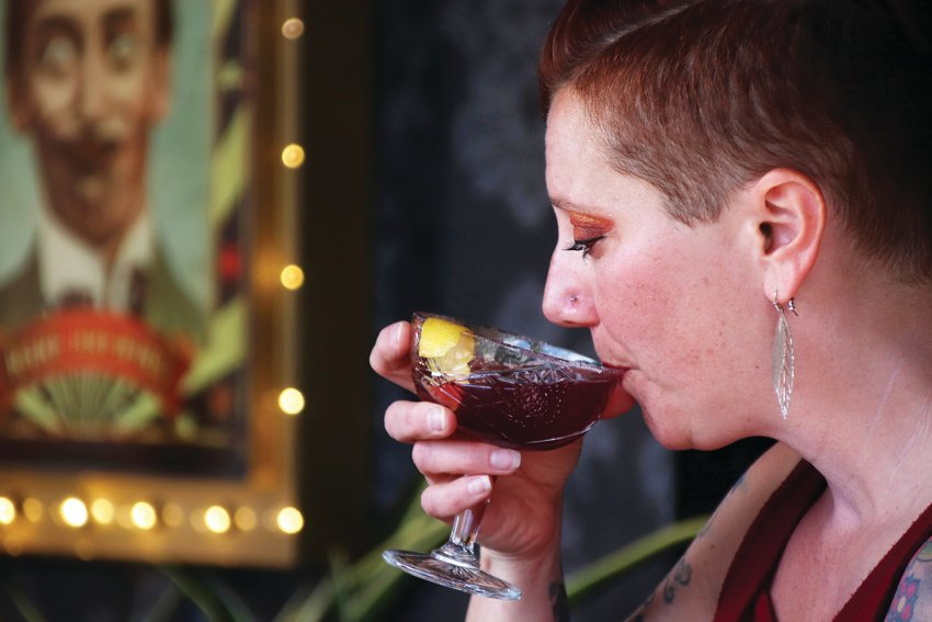 Niki Greco sips her drink at Rare by Grist on April 25.