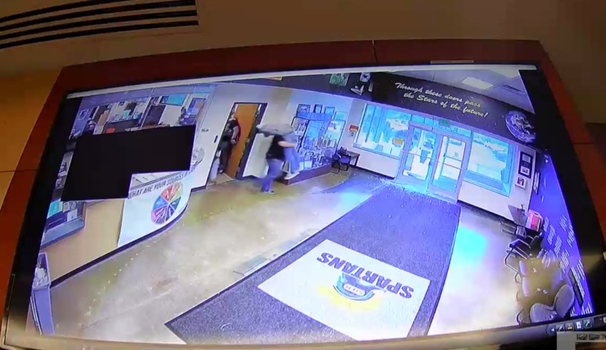 Surveillance footage from inside STEM School Highlands Ranch shows Sgt. Joel White with the Douglas County Sheriff's Office carrying a wounded student out of the school on May 7, 2019. The footage was played during the trial for Devon Erickson, who is facing dozens of charges for his alleged role in the attacks.