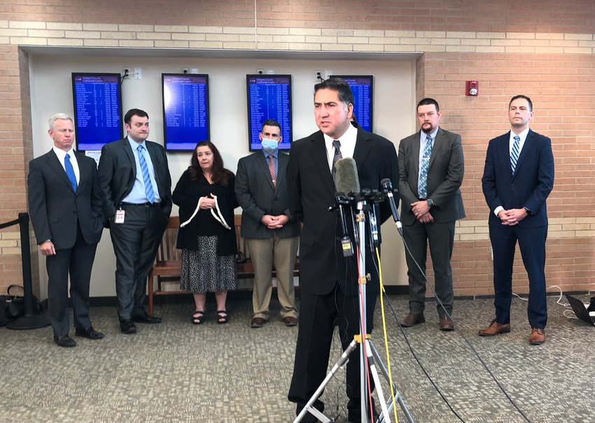 John Castillo speaks with reporters June 15 after a jury found Devon Erickson, the person who fatally shot his son, guilty of first-degree murder. He stood in front of investigators and prosecutors from the district attorney's office.