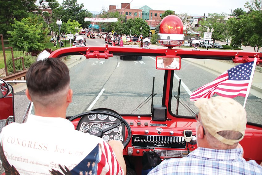 The view from atop a vintage fire truck as the Fire Muster parade rolls down Main Street.