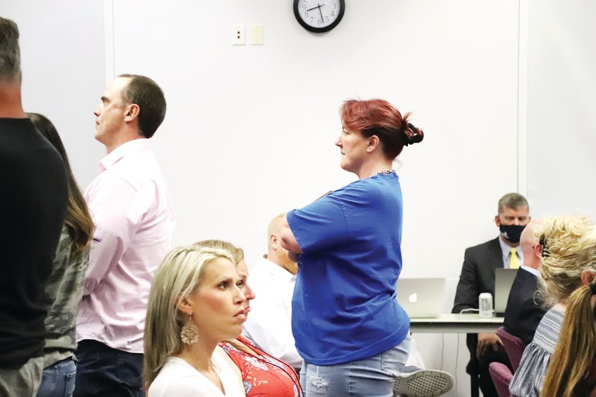 People who attended the Aug. 24 Douglas County School Board meeting stood in support of comment they supported and faced the back of the room when they disagreed with public comment.