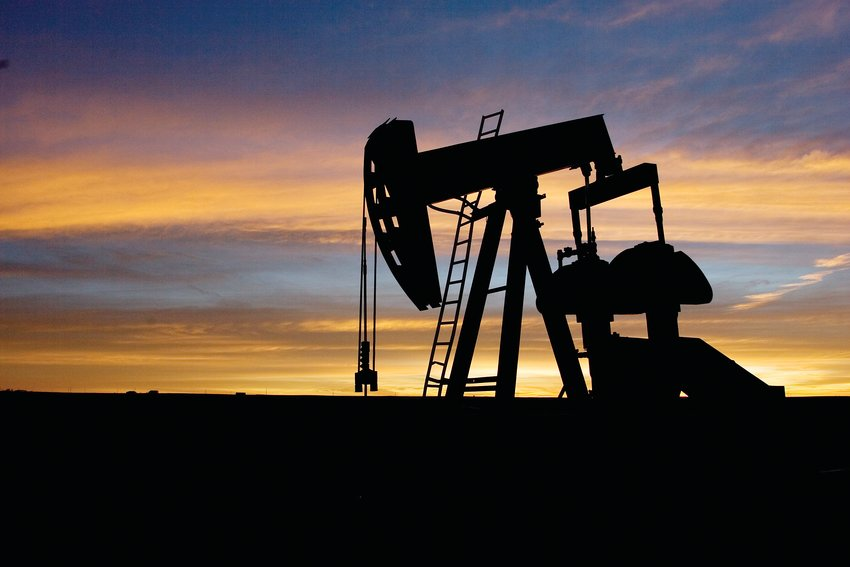 An oil well pumpjack at sunrise in eastern Colorado.
