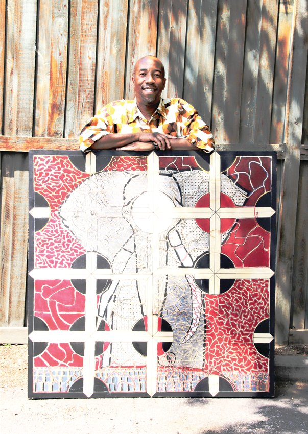"""Warren Stokes of Denver's Washington Park neighborhood stands with one of his maze art pieces called """"Ivory vs Enamel."""" Stokes uses his art as a healing mechanism, in his profession as a teacher and for activism."""