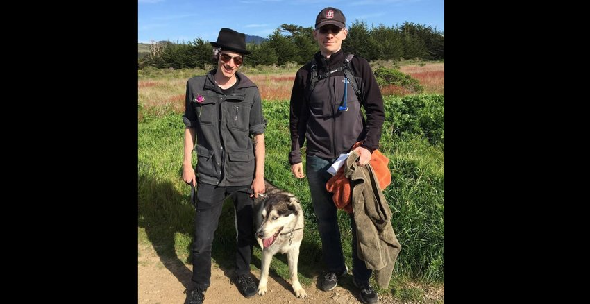 Joe Hix, left, his brother Dean Lockhead, and Lockhead's dog Fenriz on a hiking trip a few years before Hix was killed.