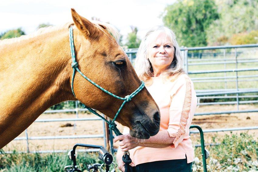 Lifelong horse owner Karen Richard with her horse, Summer.