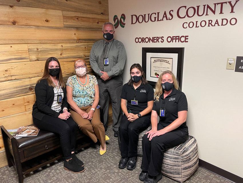 Douglas County Coroner's Office staff: (from left) Jessica Carlos, Senior Forensic medicolegal death investigator; Jill Romann, coroner; Nick Lobello, chief deputy coroner; Taylor Lowry, MDI; Lauren Stockton, manager of coroner administration.