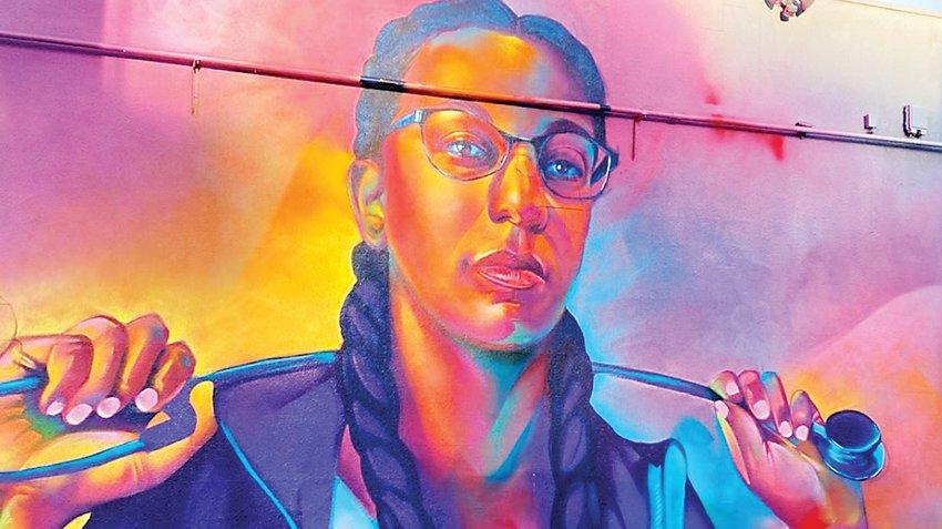 "A mural of Denver Health nurse Trina Fernandes painted by Thomas ""Detour"" Evans."