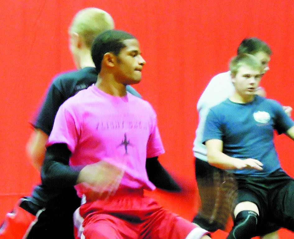 Elizabeth High senior Gavril Houston, practicing with Cardinals teammates on Nov. 26, is one of the preseason favorites in the 120-pound weight class.