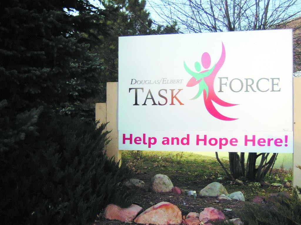 Staff members at the Douglas/Elbert Task Force, 1638 Park St., Castle Rock, have a daily limit. They help the first 20 families who sign up. But this time of year, staff is being swamped, and on a recent evening were trying to help more.