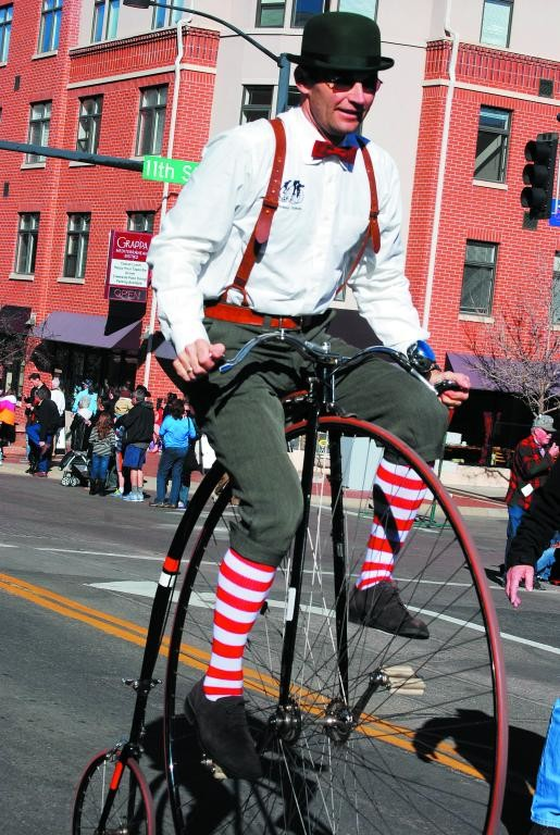 Paul Kvasnovsky balances himself as he rides a reproduction Penny Farthing or high wheel bicycle.