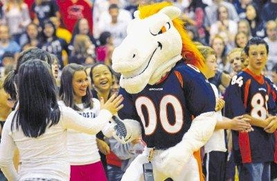 Miles, the Denver Broncos mascot, visits with students at Sierra Middle School on Oct. 7 as part of the Fuel Up to Play 60 program. There will be a Denver Broncos pep rally at 4 p.m. Feb. 1 at Ponderosa High School.