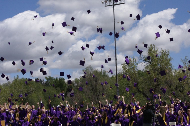Purple hats fill the air as members of the Littleton High School Class of 2011 mark the fact they are now high school graduates. The hat toss was the final event at the May 20 commencement ceremonies at Littleton Public Schools stadium. Photo by Tom Munds