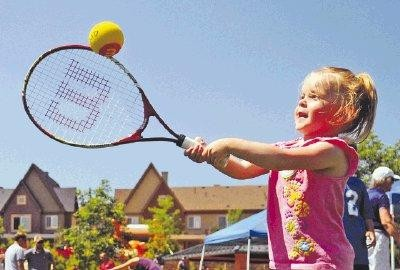 Ashleigh Wilson plays a lawn tennis game with equipment from a Highlands Ranch Metro District Picnic Pack last summer. File photo