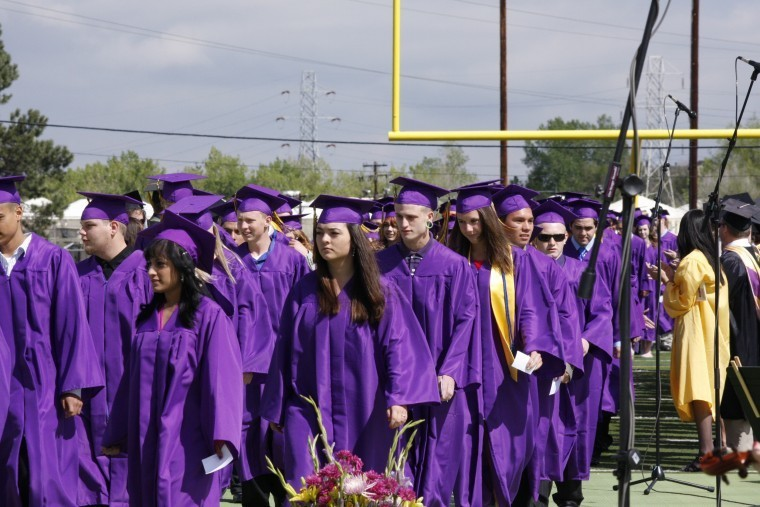 Members of the Littleton High School Class of 2011 make their way to their seats in preparation for their May 20 commencement ceremonies at Littleton Public Schools Stadium. This is the 106th class to graduate from Littleton High School. Photo by Tom Munds
