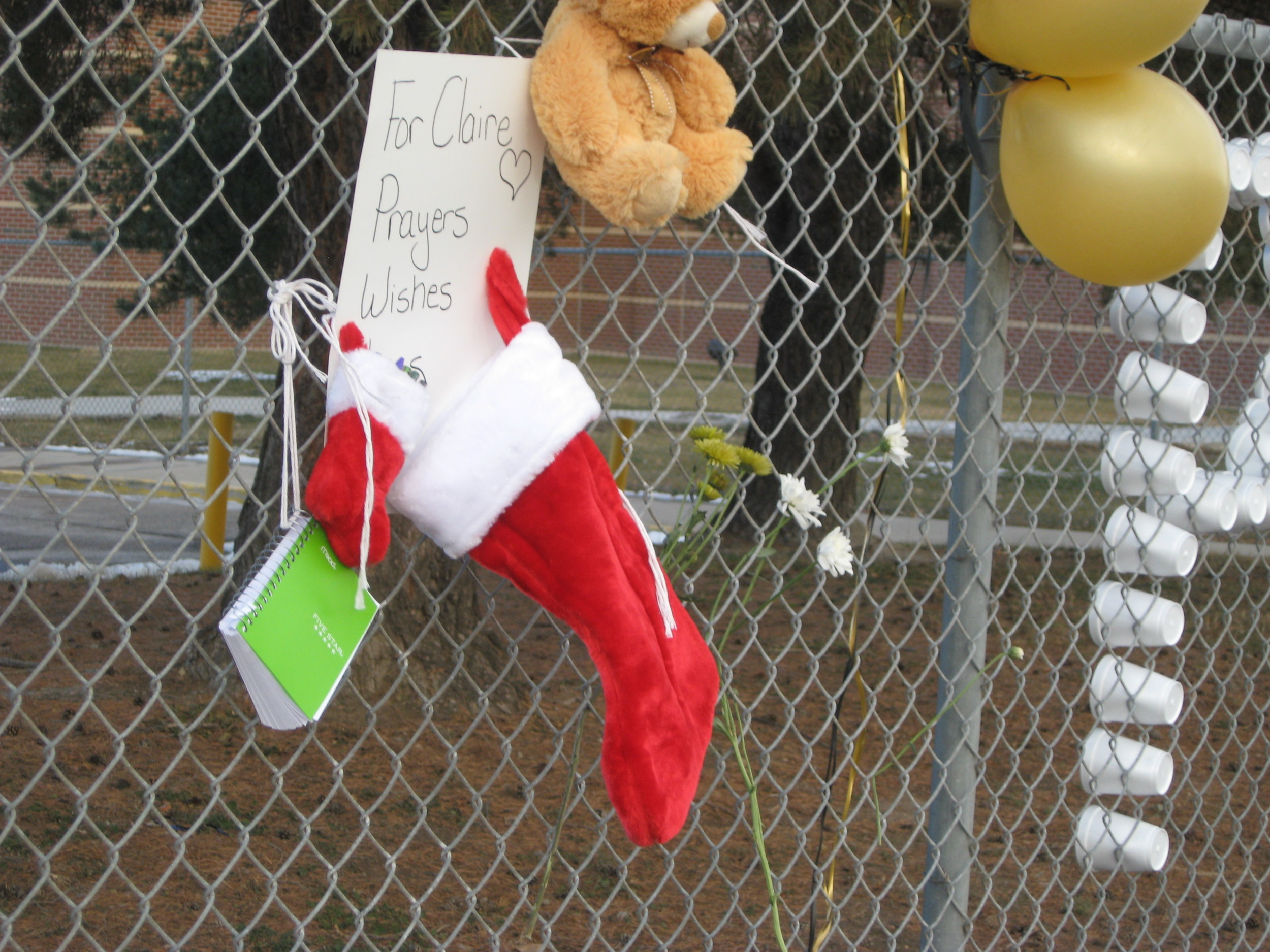 A Christmas stocking was among the many signs of support Sunday at Arapahoe High for Claire Davis, the 17-year-old student who is in critical condition after the Dec. 13 shooting at the school.