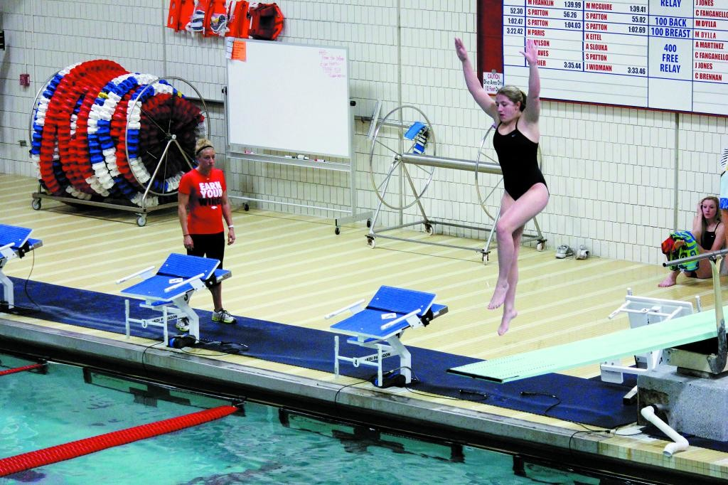 Heritage sophomore Kaela Shandle gets some spring action Dec. 17 during the Eagle's 223-143 victory over Mountain Vista. Shandle went on to win the diving competition with a score of 206.85 to help Heritage win the dual meet at Heritage High School.