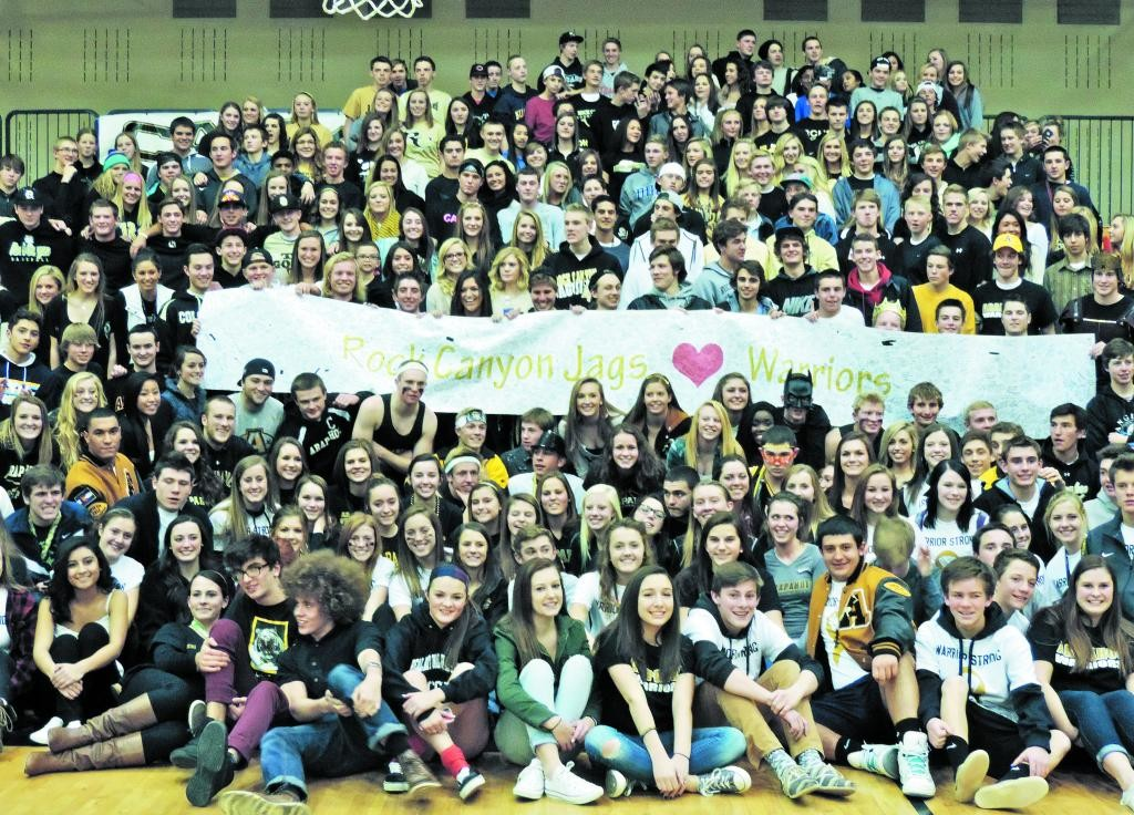 At halftime of the Dec. 20 game, the Arapahoe High student section was invited to join the Rock Canyon students, who showed support with a large sign.