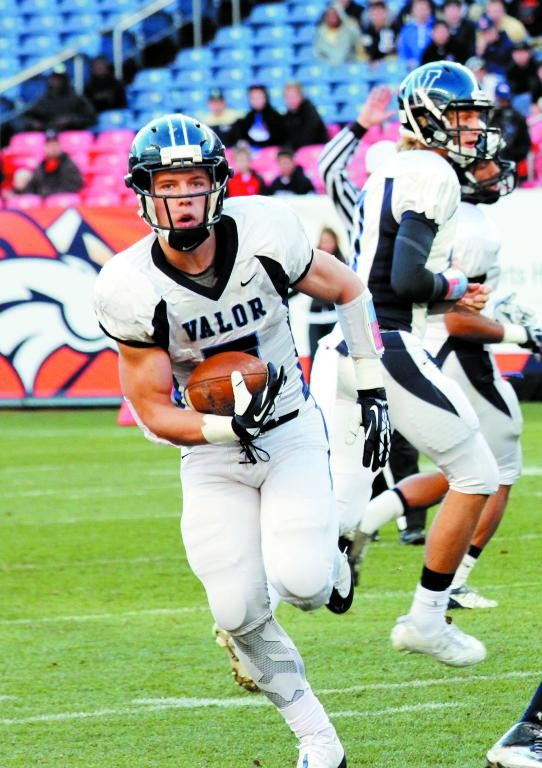 Valor Christian senior Christian McCaffrey (5) runs the ball for the Eagles during the Class 5A state championship game against Fairview. McCaffrey is this year's selection for offensive player of the year.