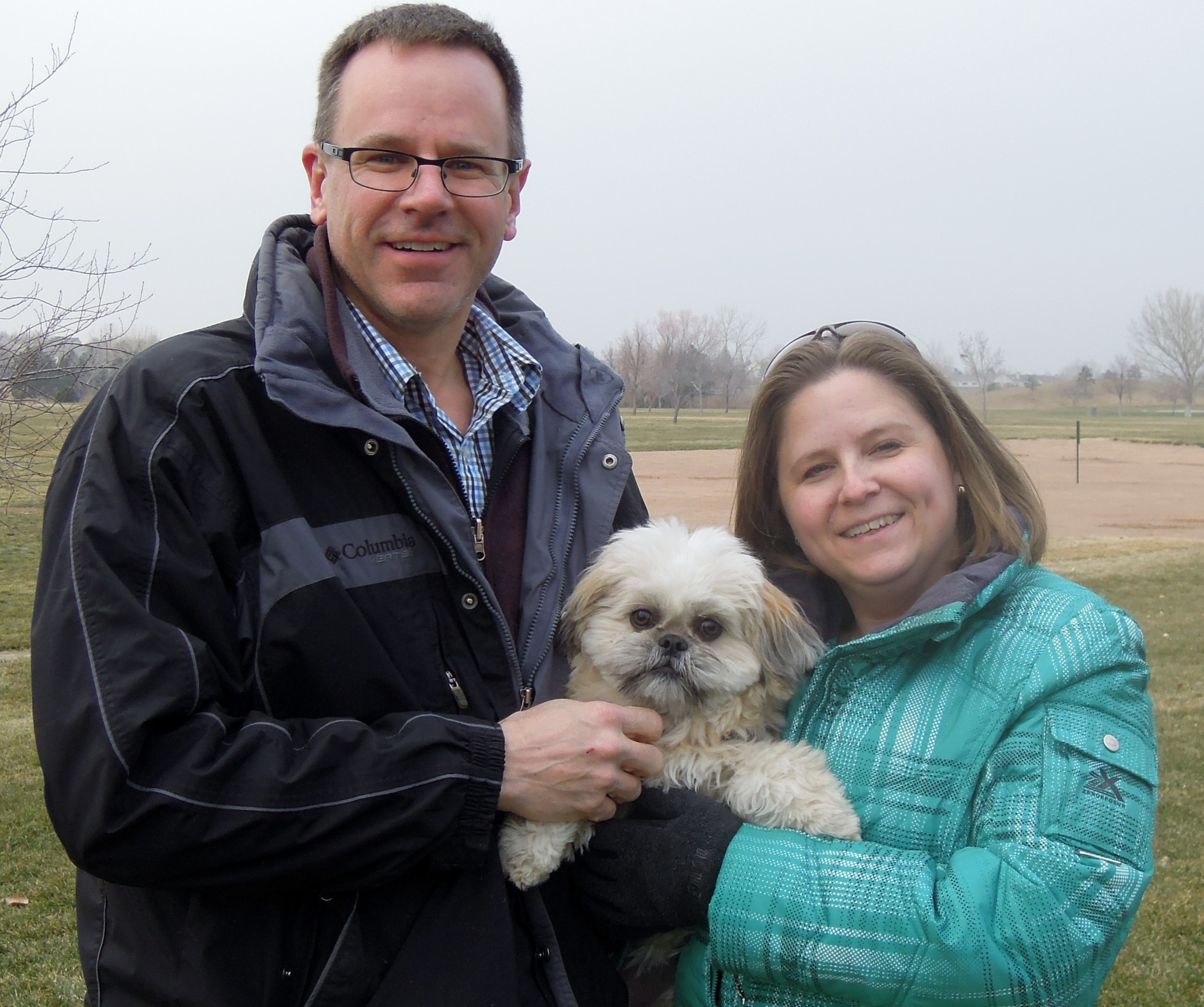 Castle Rock husband-and-wife Morris Hansen and Denise Waggoner hold Lilo during one of her rare still moments at Highlands Ranch's Heritage Regional Park.