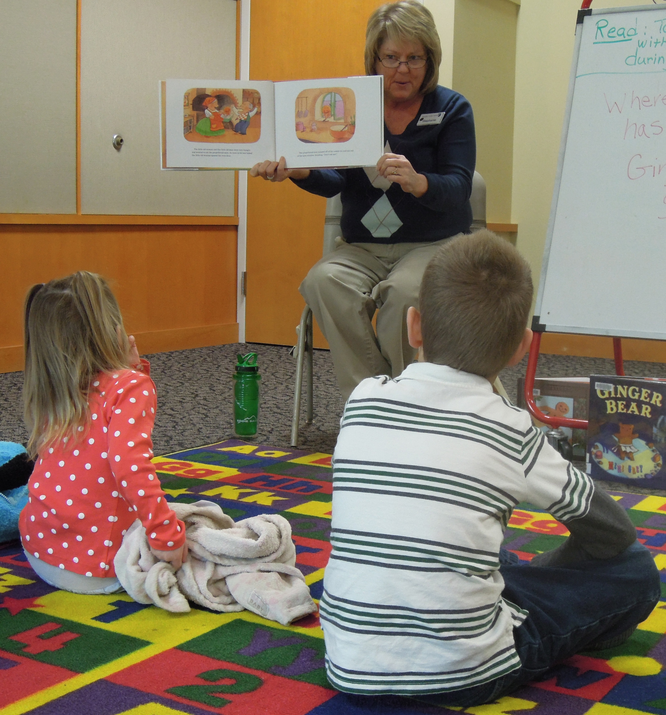 Stephanie Rogers of Douglas County Libraries reads to children during a Dec. 26 story hour at the Highlands Ranch library.