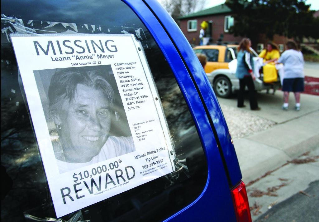 "A flyer of missing Wheat Ridge resident Leann ""Annie"" Meyer is posted on the side of a vehicle as family and friends prepare for a candlelight vigil Saturday, March 30, at her 4710 Newland St. residence. Meyer had been missing since Feb. 7, 2013."