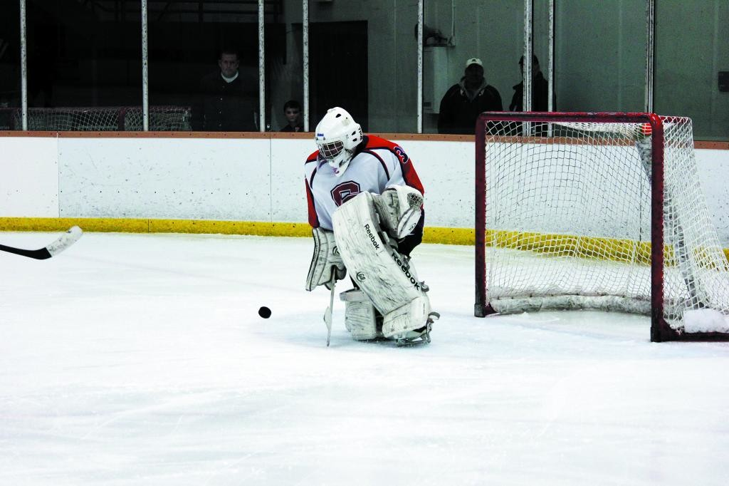 Cherry Creek goalie Aaron Jatana turns aside a shot during the Dec. 20 game against Mountain Vista. Jatana made 33 saves but the Golden Eagles won the game, 4-3 in overtime.