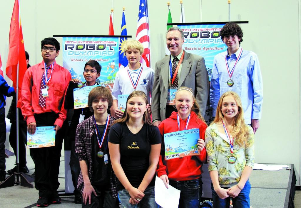 Pictured are, from L to R, back row: Sanskaar Saxena (Cresthill MS - Special Award in Creative Category); Akshant Lanjewar (Pine Grove Elementary - Bronze Medal in Creative Category Jr); Sam Zimmer (DCHS - Gold Medal Creative Category); Randy Menzer, US IRO representative; Ryan Ham (Legend HS - Gold Medal Creative Category). Front row: Matt Mahoney (Highlands Ranch HS - Bronze Medal Robot Dance) with Gillian Menzer and Audrey Menzer (both from Douglas County HS); and Haley Steinke (CRMS) Gold Medal in Creative Category.